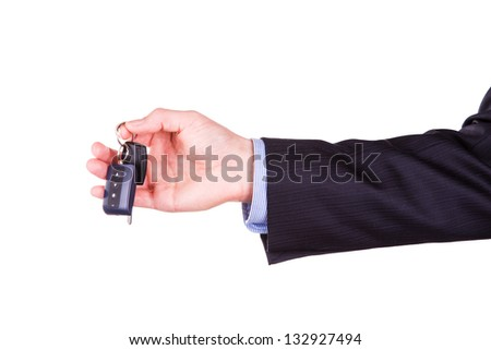 Male hand holding a car key isolated on white background. New car concept