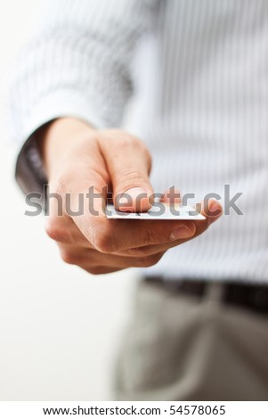 Male hand holding a card - stock photo