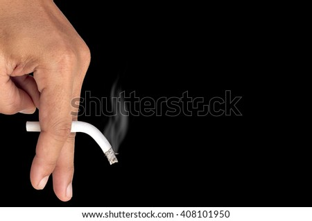 Male hand holding a cigarette, Isolated on black background, Concept cigarettes causes sexual dysfunction. - stock photo