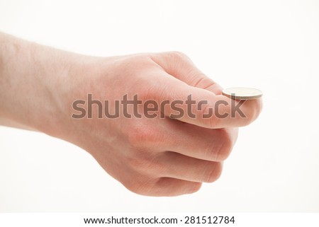 Male hand holding a coin, white background - stock photo