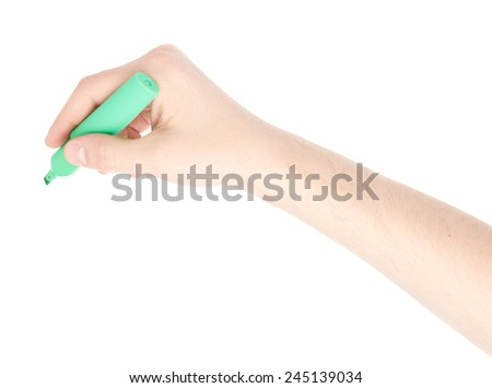 Male hand holding a green marker over the white surface, composition isolated over the white background - stock photo