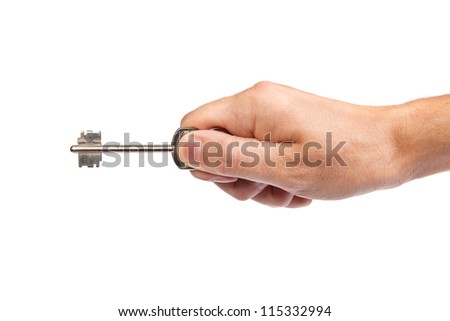 Male hand holding a key to the house, image is taken over a white background. - stock photo