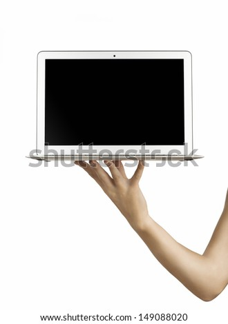 male hand holding a laptop, isolated on white - stock photo