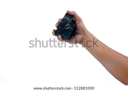male hand holding a little lump of coal  isolated on white background