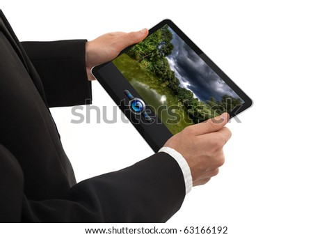 male hand holding a touchpad pc showing a movie, isolated on white - stock photo