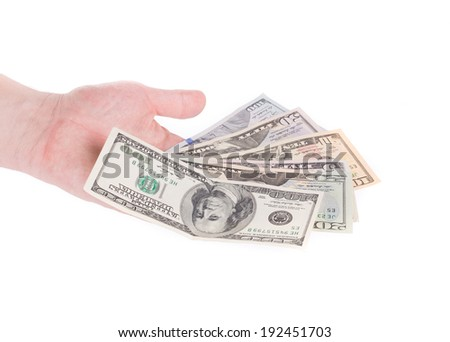 Male hand holding american dollar-bills. Isolated on a white background.