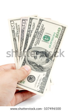 Male hand holding american Dollar-bills, isolated on white - stock photo