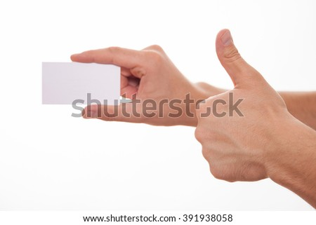 Male hand holding an empty business card and showing thumb up sign, white background - stock photo