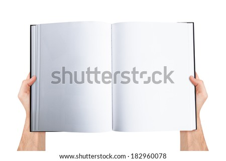 Male hand holding blank empty open book with copy space for your message, top view, isolated on white background. - stock photo
