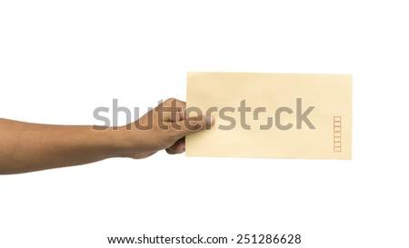 Male hand holding blank envelope isolated on white background - stock photo