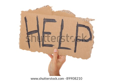 Male hand holding cardboard sign with the term help. All on white background. - stock photo