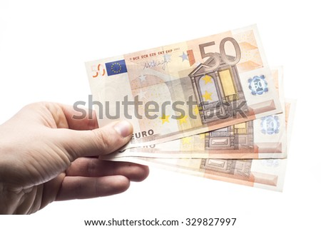 Male hand holding cash isolated on white background