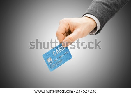 Male hand holding credit card - paying concept - stock photo