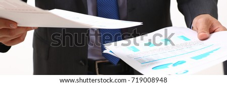 Male hand holding document with graph on seminar. Bank credit, loan money, invest, tax situation review, income calculation form, white collar train, investment audit, board members session concept