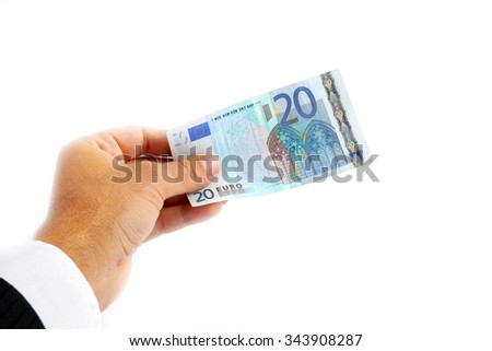 male hand holding 20 euro banknote on white background