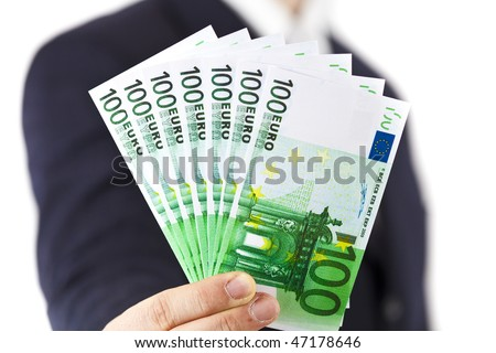 Male hand holding 100 euro bill isolated on white