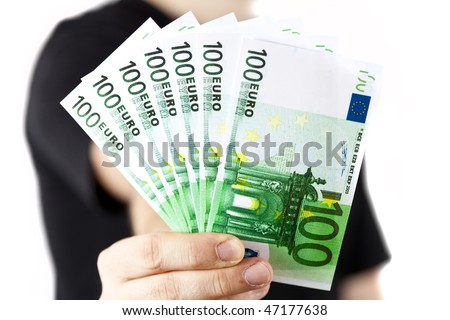 Male hand holding 100 euro bills isolated on white