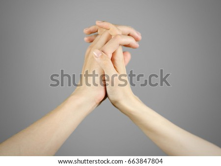 Male hand holding female hand. Isolated.