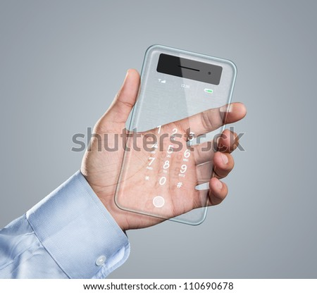 Male hand holding futuristic transparent mobile smart phone with copy space - stock photo