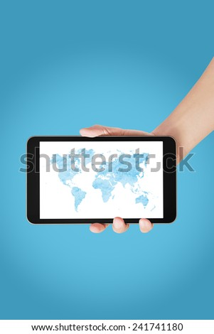 Male hand holding graphic digital map on tablet on blue background - stock photo