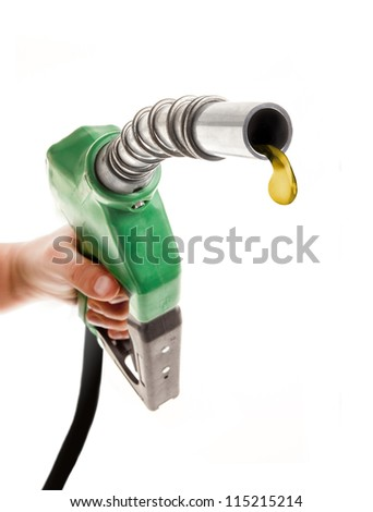 Male hand holding green gas nozzle with one last drop on white background