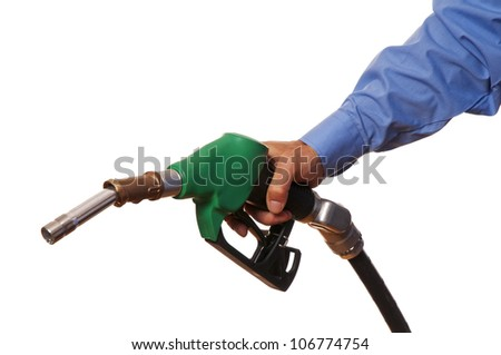 Male hand holding green pump isolated on white - stock photo