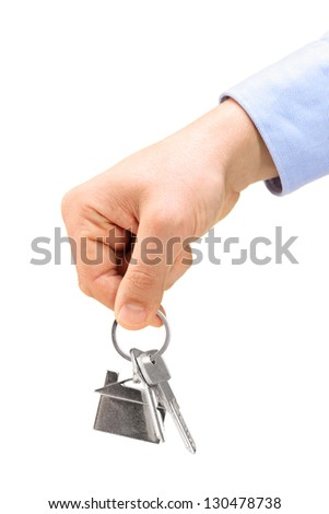 Male hand holding keys on a key ring, isolated on white background