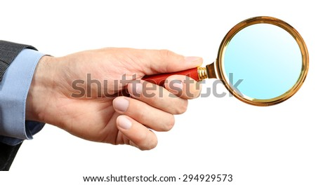 Male hand holding magnifying glass isolated on white