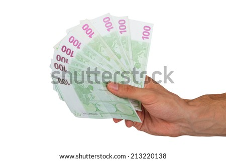 Male hand holding one hundred euro money banknotes, isolated on white background. - stock photo