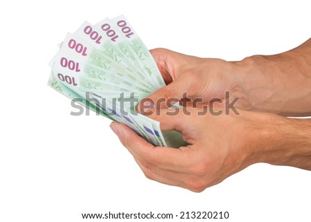 Male hand holding one hundred euro money banknotes, isolated on white background. - stock photo