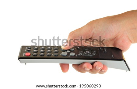 Male hand holding remote control - stock photo