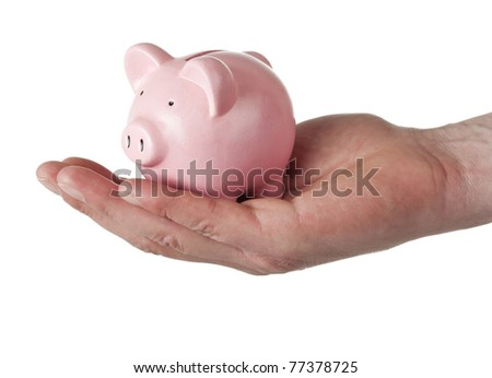 male hand holding small pink piggy bank, isolated on white