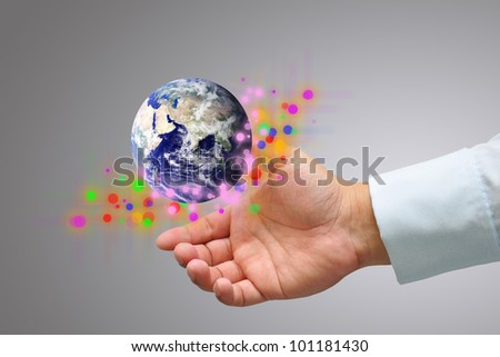 Male hand holding the Earth : Elements of this image furnished by NASA