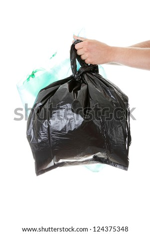 Male hand holding waste bags, isolated on white