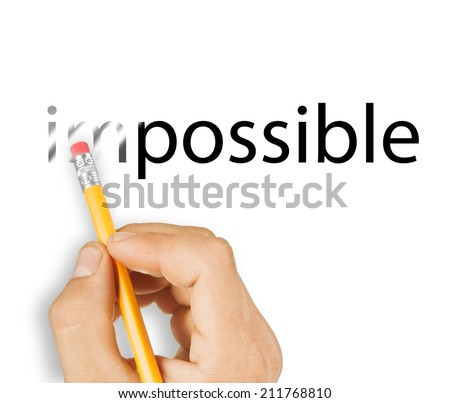 """Male hand holding wooden pencil and erase letters """"IM"""" from word """"IMPOSSIBLE - stock photo"""