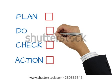 male hand is checking on the PLAN DO CHECK ACTION list for the business concept use