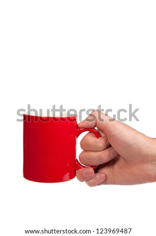 Male hand is holding a red cup isolated on a white background