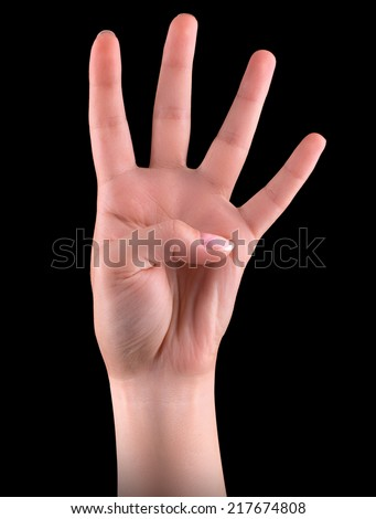 Male hand is showing four fingers isolated on black background - stock photo
