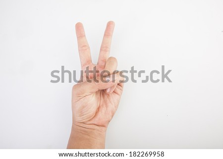 Male hand is showing two fingers isolated on white background - stock photo
