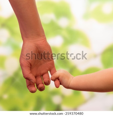 Male hand leading child, trust family concept - stock photo