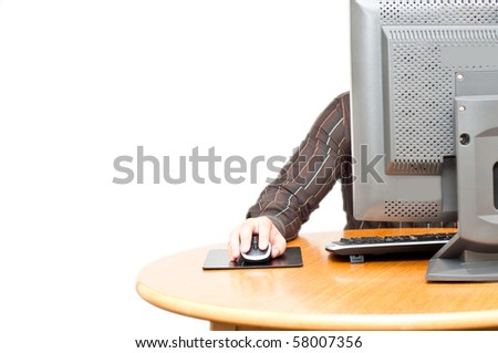 male hand on mouse and computer screen visible - stock photo