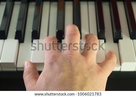 male hand on the piano