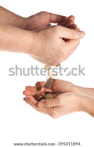 Male hand palm poured trifle penny in the palm of women's hands. On a white background isolation - stock photo