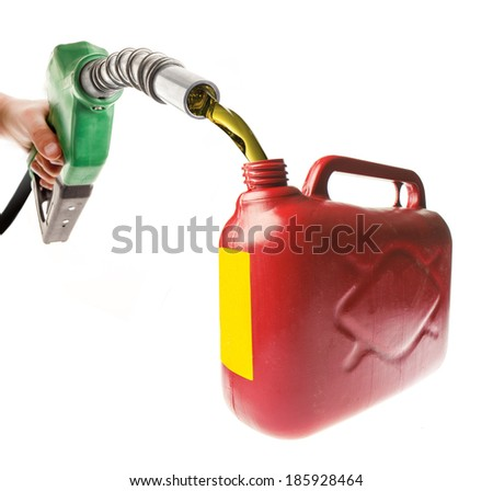 Male hand pouring gasoline in a red canister with a green nozzle on white - stock photo