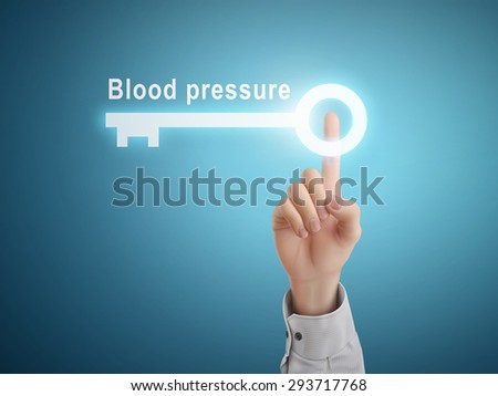 male hand pressing blood pressure key button over blue abstract background - stock photo