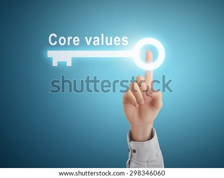 male hand pressing core values key button over blue abstract background  - stock photo
