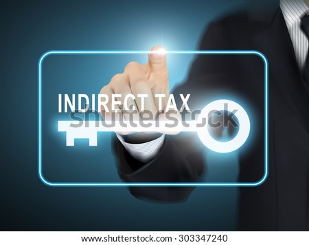male hand pressing indirect tax key button over blue abstract background - stock photo