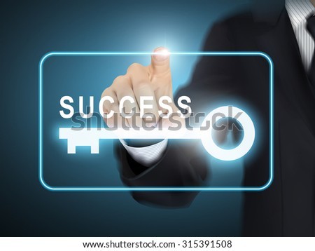 male hand pressing success key button over blue abstract background