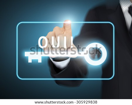 male hand pressing YES word in French over blue abstract background - stock photo