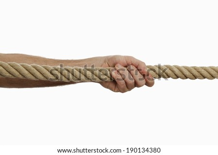 Male hand pulling a rope - stock photo